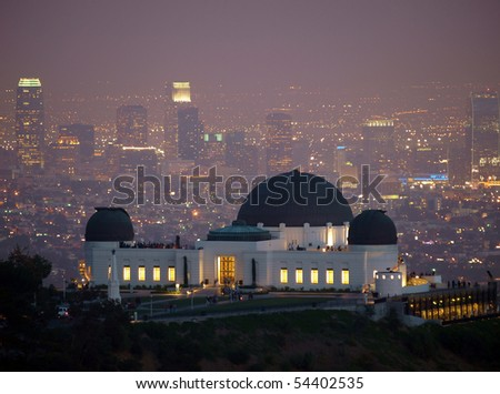 Visitors flock to Los Angeles's city owned Griffith Park Observatory on a slightly foggy night.