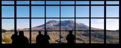 Visitors look at Mount St. Helens from the Johnston Ridge Observatory