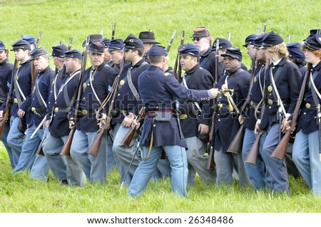 Union Army soldiers on the battlefield in a Civil War reenactment