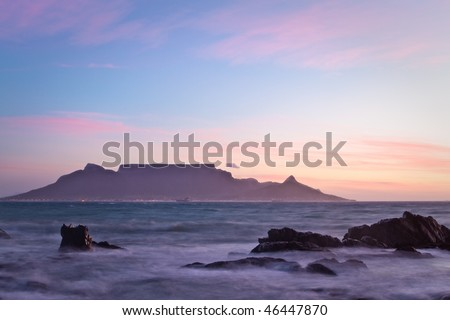 Vista of Table Mountain at dawn as seen from Bloubergstrand