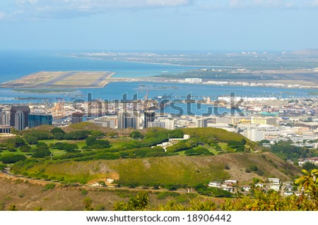 Vista overlooking Honolulu's National Cemetery of the Pacific (Punchbowl) with harbor and airport behind