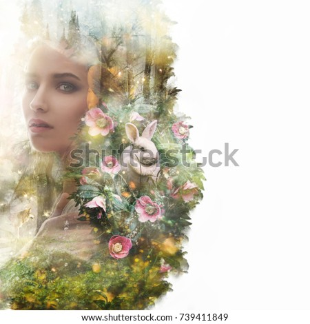 Stock Photo Visual digital art. Fairytale young woman portrait. Double exposure effects. Wood nymph surrounded by animals in a magical forest full of lights. Fantasy creature elf in magic wood. Book cover concept