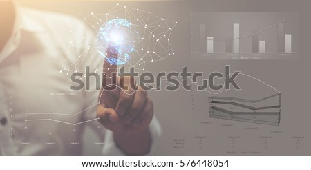 Photo of  Visual effects. Future technology touch screen interface. Handsome African American businessman in shirt touching screen interface, drawing a chart in futuristic office. Selective focus on the hand