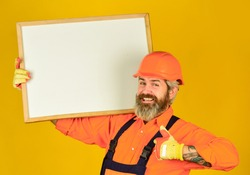Visual outline. Troubleshoot concept. Bearded man repairman builder. Plan repair works. Repairman hold whiteboard copy space. Handsome repairman. Architect showing project. Professional repairman