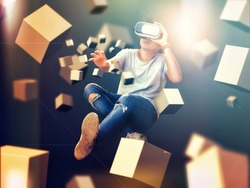 Visual reality concept.Young Asian man using Visual reality or VR headset  and interacting with object.man getting experience using VR-headset glasses.