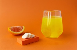 Vitamin C effervescent tablet, water soluble with orange flavor