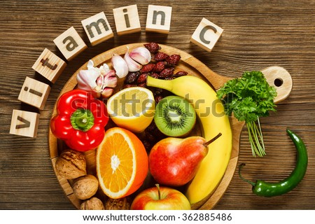 Vitamin C in fruits and vegetables. Natural products rich in vitamin C as oranges, lemons, dried fruits rose, red pepper, kiwi, parsley leaves, garlic, bananas, pears, apples, walnuts, chili.
