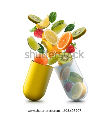 vitamin c pill open with citrus fruits jumping out Foto stock ©