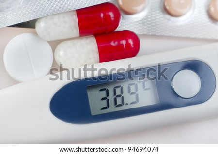 Vitamin c tablet and pills stack with thermometer