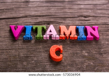 vitamin C word made from colored wooden letters on an old table. Concept #573036904