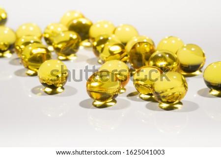 Vitamin capsules on a white background