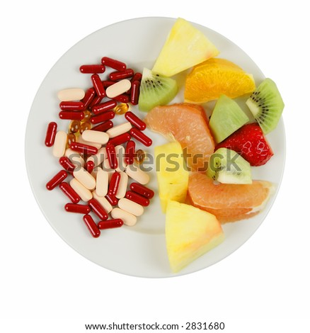 Vitamin choices on a plate:natural and artificial.......you must chose!!!...educational nutritional image.