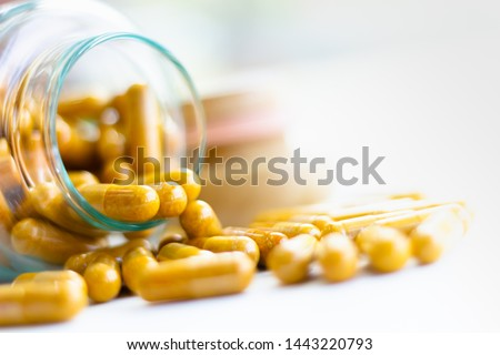 Vitamin D-3 capsules in bottle. Cod liver oil omega 3 gel capsules. Vitamins, dietary supplements, drugs, Pharmacy, medicine and health concept. capsule pharmacy bottle pill drug concept.
