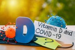 Vitamin D help in treating coronavirus. Vitamin D, coronavirus and question mark on a background of sunlight.