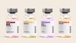 Vitamin injection glass bottles on beige background