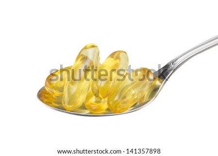 Vitamin Omega-3 fish oil capsules with spoon (with clipping path)