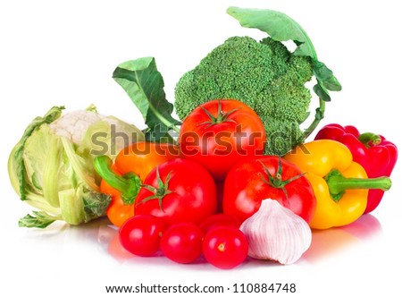 vitamin set of vegetables from the  large broccoli green leaves red ripe tomatoes, orange and yellow peppers and purple garlic with green sprigs of fresh isolated on white background