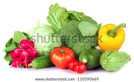 vitamin set of vegetables from the  large turnip, beets, zucchini orange and yellow pepper with green sprigs radish bright and fresh large cabbage green cucumber  isolated on white background