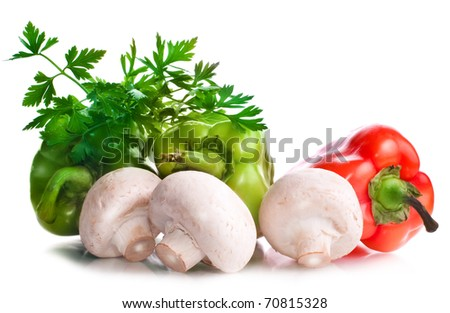 Vitamin vegetable collection: mushrooms, papers, greens isolated on a white background