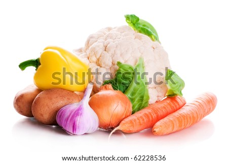 Vitamin vegetable collection: sweet pepper, a potato, onions, garlic, a cauliflower and carrots isolated on a white background