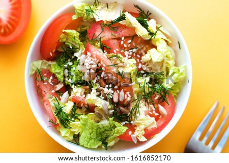 Vitamin, vegetable salad of cabbage, tomatoes, dill, sesame. Healthy food. Vegetarian food