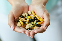 Vitamins And Supplements. Closeup Of Woman Hands Holding Variety Of Colorful Vitamin Pills. Close-up Handful Of Medication, Medicine Tablets, Capsules. Healthy Diet Nutrition Concept. High Resolution