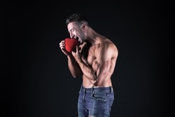 Vitamins for heart. Eat healthy. Romantic muscular guy. Man muscular macho romantic date. Fall in love sportsman. Bodybuilder muscular chest preparing for date outdoors or night out. Health care