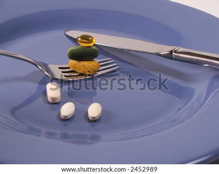 vitamins on a blue plate