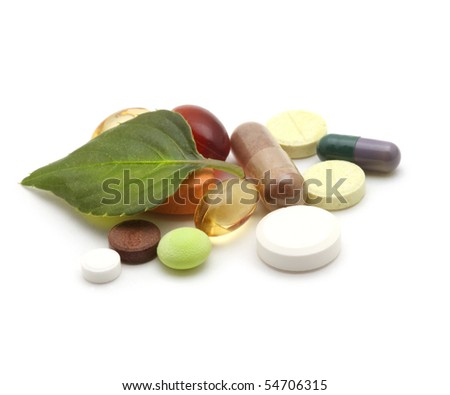 vitamins, tablets, pill and green leaf - stock photo