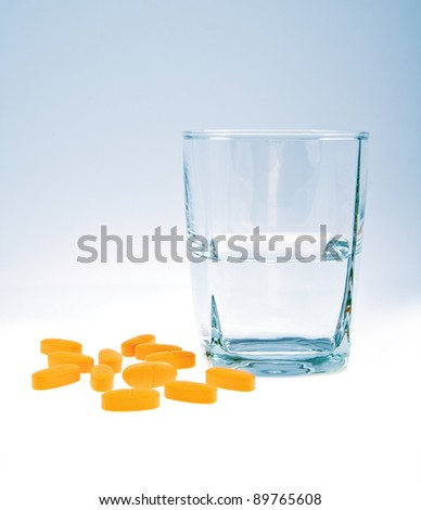vitamins with glass of water isolated