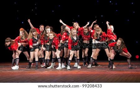 "VITEBSK, BELARUS - APRIL 2: Unidentified children from dancing group ""Belka"" at a concert ""Dancing group ""Belka"" collects friends"" on April 2, 2012 in Vitebsk, Belarus - stock photo"