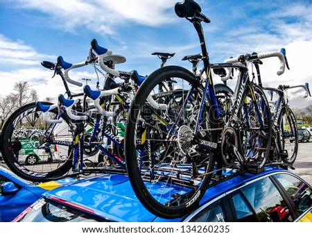 VITORIA-GASTEIZ, SPAIN - APRIL 3: A cycling team car carrying bikes in the Tour of the Basque Country. April 3, 2013 in Vitoria Gasteiz, Basque Country, Spain