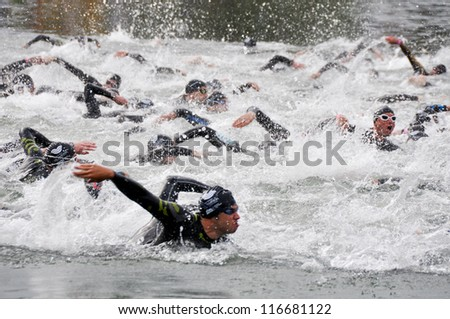 VITORIA-GASTEIZ, SPAIN - JULY 29 : Athletes competing in the swimming section in the Long Distance Triathlon World Championships, July 29, 2012 in Vitoria Gasteiz, Basque Country, Spain