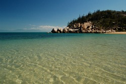 Vivid aqua waters against rocky headland of Arcadia Bay Magnetic Island Queensland Australia