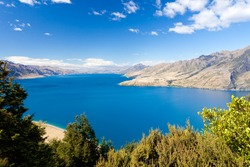 Vivid blue surface of big mountain Lake Hawea, Central Otago, New Zealand