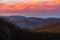 Vivid clouds at sunrise over Shenandoah National Park in the Winter viewed from Mount Marshall.