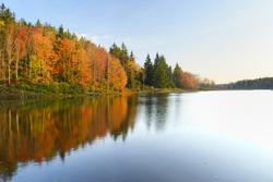 Vivid Colors of Fall Trees Reflecting in Lake
