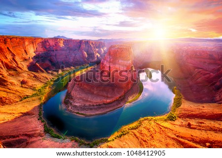 Vivid dramatic sunset over Horseshoe Bend, a famous meander on river Colorado near the town of Page. Arizona, USA