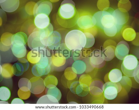 Vivid glowing green glowing round blurred lights abstract background #1033490668