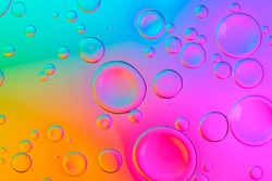 Vivid neon background with bubbles. Colorful abstract backdrop with bright gradients on blobs. Multicolor overflowing picture.