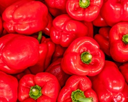 vivid red bell peppers top view closeup, natural colorful pattern background