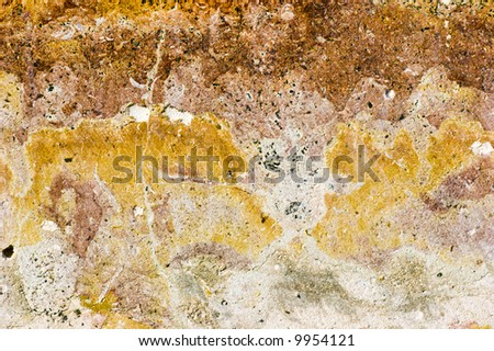 Vivid spotted textured background made from natural stone