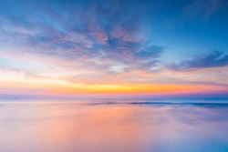 Vivid twilight sunset sky and motion blur of the sea under with long exposure effect.