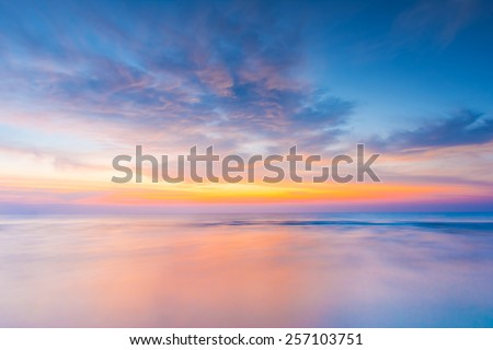 Vivid twilight sunset sky and motion blur of the sea under with long exposure effect. #257103751
