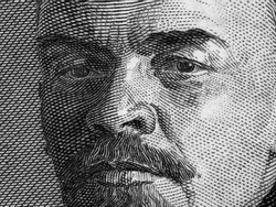 Vladimir Lenin portrait on old Russia ruble banknote macro, leader of Russian Revolution 1917, black and white.