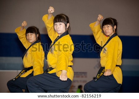 VLADIVOSTOK, RUSSIA - JULY 31: Participants from Chine compete at the sixth annual WTF World Taekwondo Poomsae Championship on July 31, 2011 in Vladivostok, Russia.