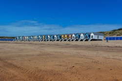 Vlissingen - beautiful sandy beach with colorful houses in a row. Sunny, quiet, relaxing place.