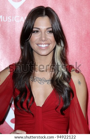 vLOS ANGELES - FEB 10:  Christina Perri arrives at the 2012 MusiCares Gala honoring Paul McCartney at LA Convention Center on February 10, 2012 in Los Angeles, CA