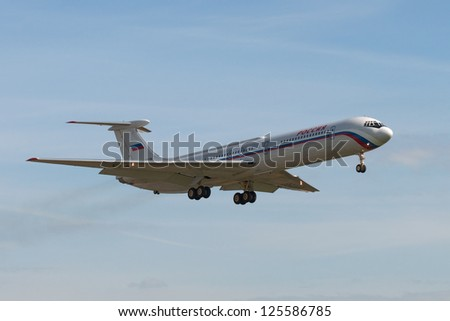 VNUKOVO, RUSSIA - SEPTEMBER 21: Aircraft operated by Rossiya Airlines OJSC, landing in Moscow airport Vnukovo on September 21, 2012. The company Rossiya OJSC in its fleet has 6 aircraft Ilyushin Il-62