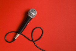 Vocal audio microphone on a bright red background